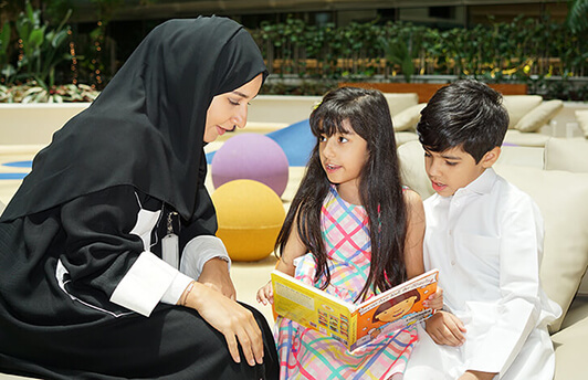 Woman Reading with Children